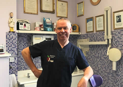 Brian McEniff, Dentist, stood in his dental surgery